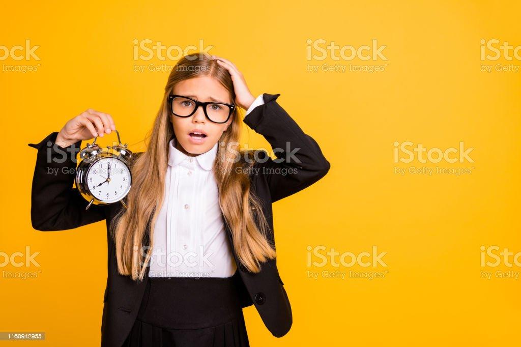 Portrait of beautiful sad kid hold, hand clock have stylish trendy...