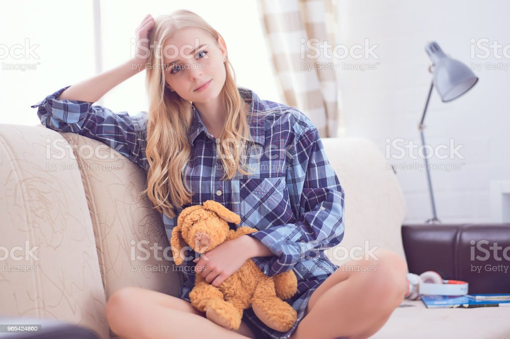 Portrait of beautiful schoolgirl sitting at home, looking at camera royalty-free stock photo