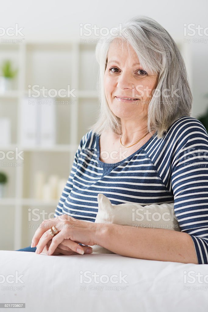 Portrait of beautiful senior woman at home stock photo