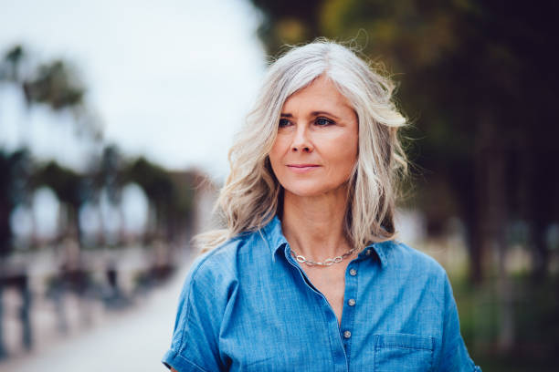 Portrait of beautiful senior woman with grey hair outdoors stock photo