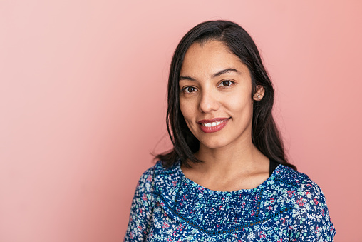 istock Portrait of beautiful smiling Mexican millennial woman 1130172009