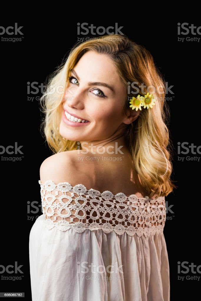 Portrait of beautiful smiling woman against black background stock photo