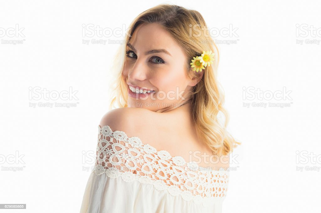 Portrait of beautiful smiling woman against white background stock photo