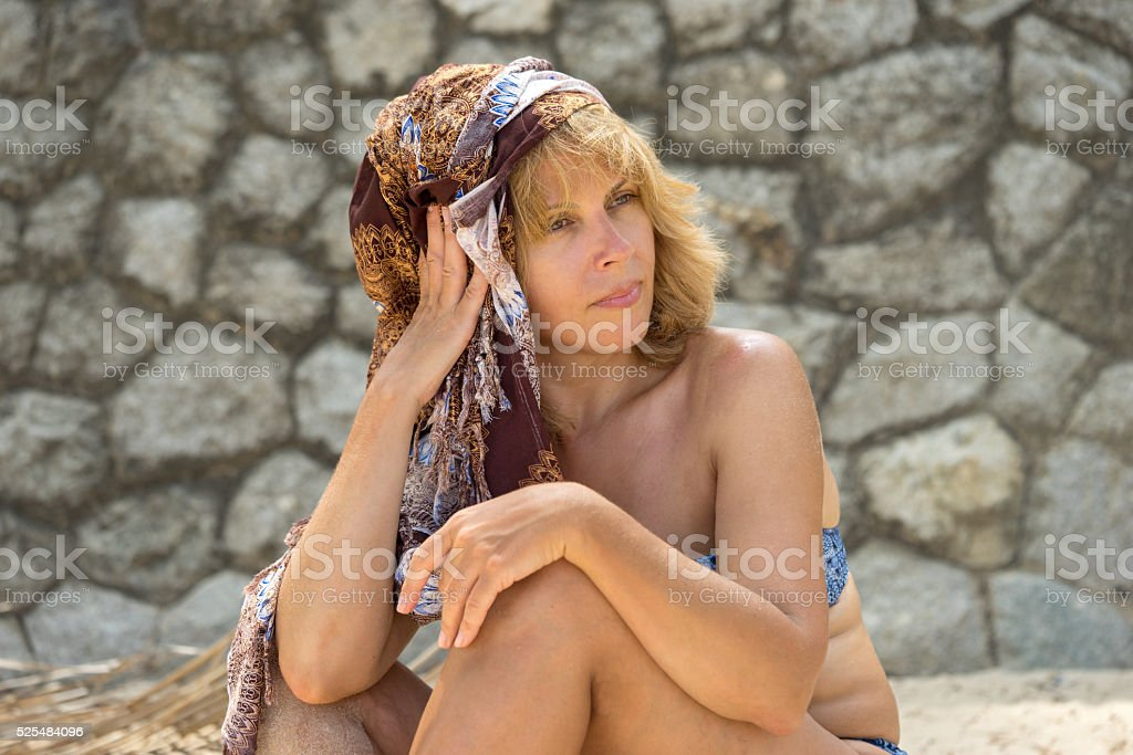 portrait of beautiful sunburnt adult caucasian woman stock photo