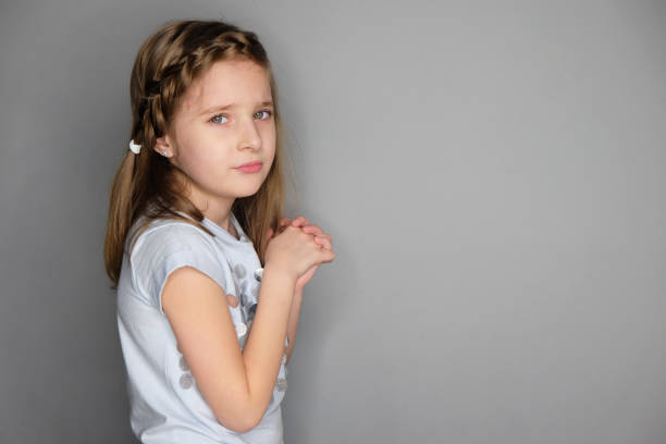 Portrait of beautiful upset little girl stock photo