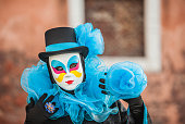 Portrait of Beautiful Venice Carnival Mask in Blue and Black Color