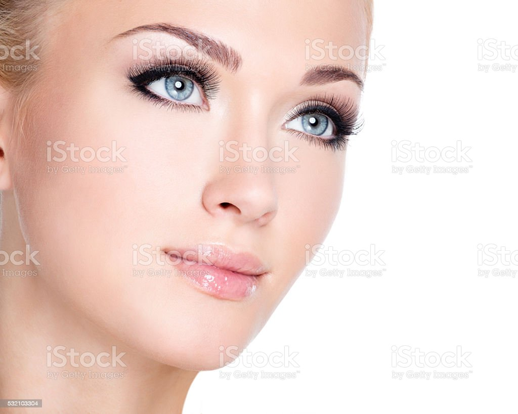 portrait of beautiful white woman with long false eyelashes stock photo