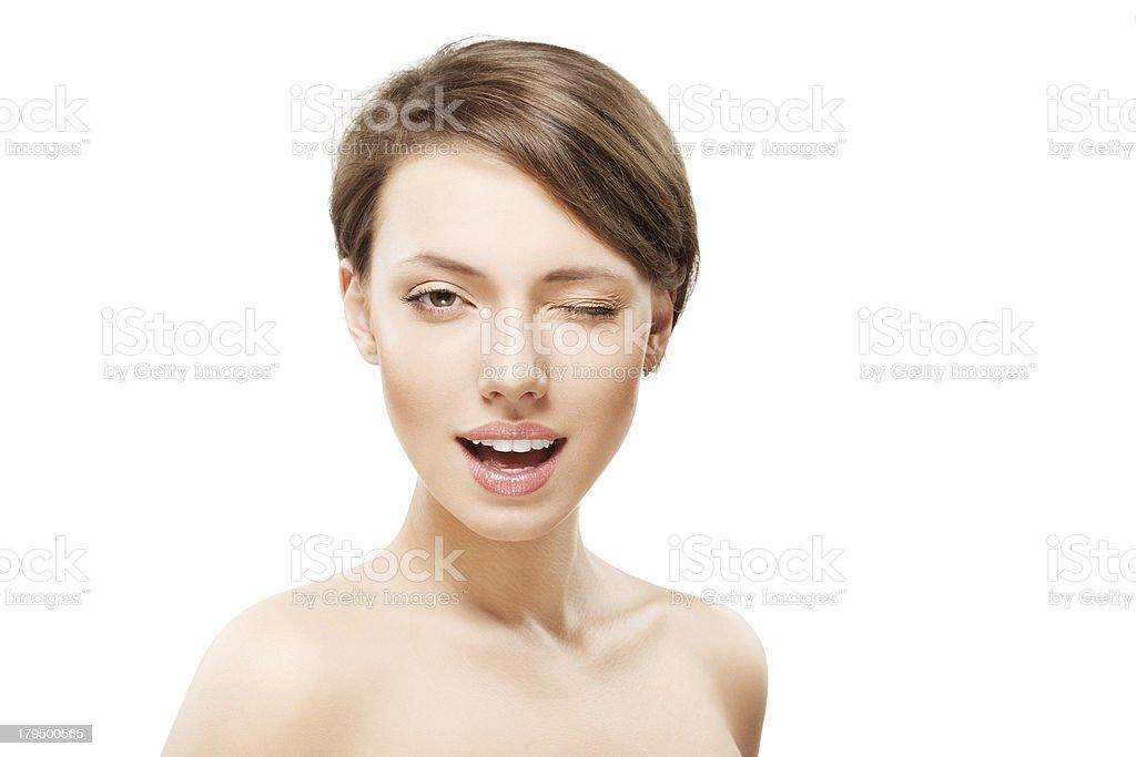 Portrait of beautiful winking girl stock photo