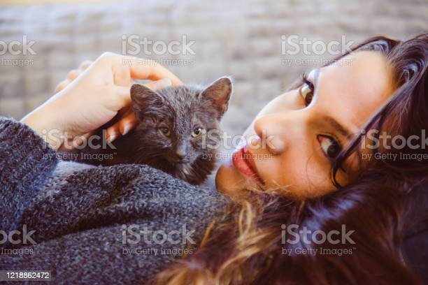 Portrait of beautiful woman caressing and playing with a street cat picture id1218862472?b=1&k=6&m=1218862472&s=612x612&h=chr2h8ytuctjcp4ssgdf7t7qflffihxfljixgaxbca4=