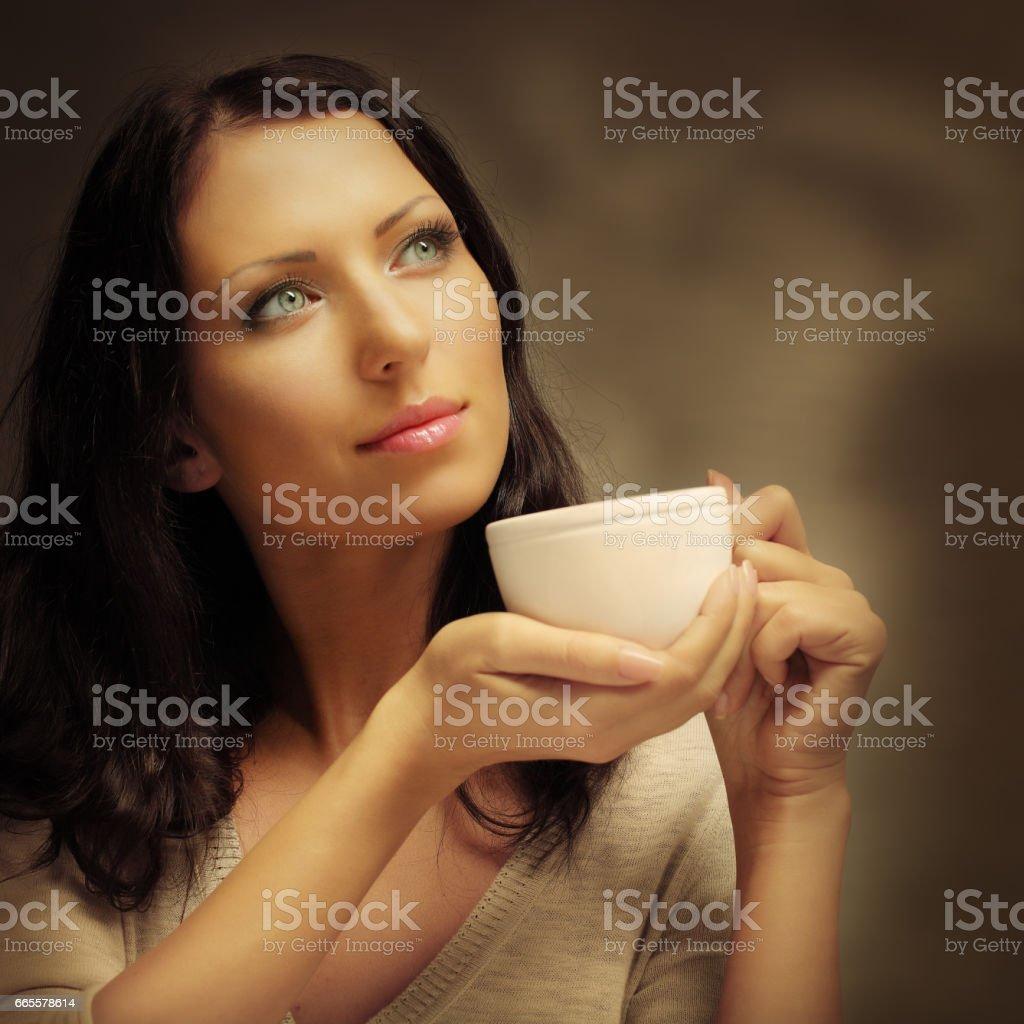 Portrait of beautiful woman drinking coffee stock photo