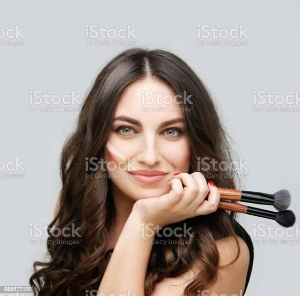 Portrait of beautiful woman holding makeup brushesputting makeup and picture id688572120?b=1&k=6&m=688572120&s=612x612&h=nsfcrcnlr8nhhhja61ggdozx5pki3u4g3geeuow1tok=