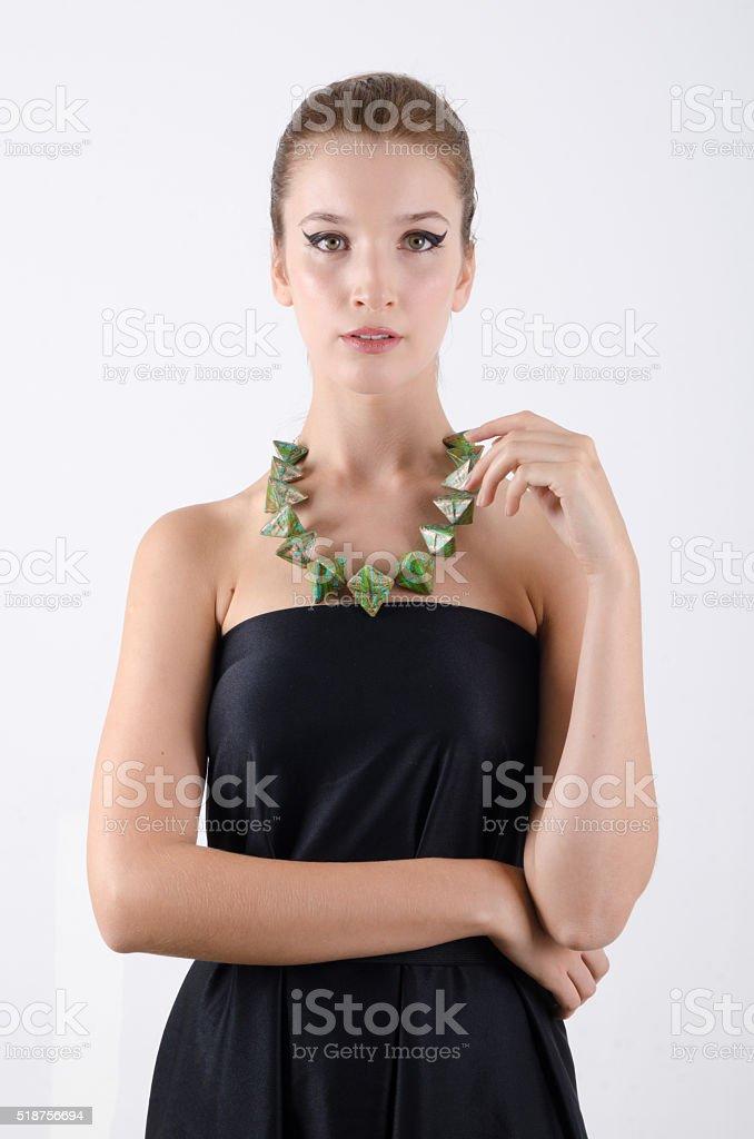 f32059ee4 Retrato de bella mujer en vestido negro con collar foto de stock libre de  derechos