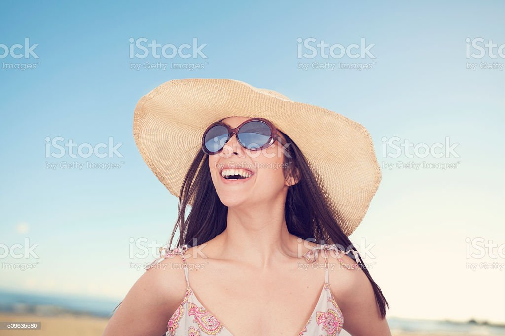 Portrait of beautiful woman in hat on summer vacation stock photo