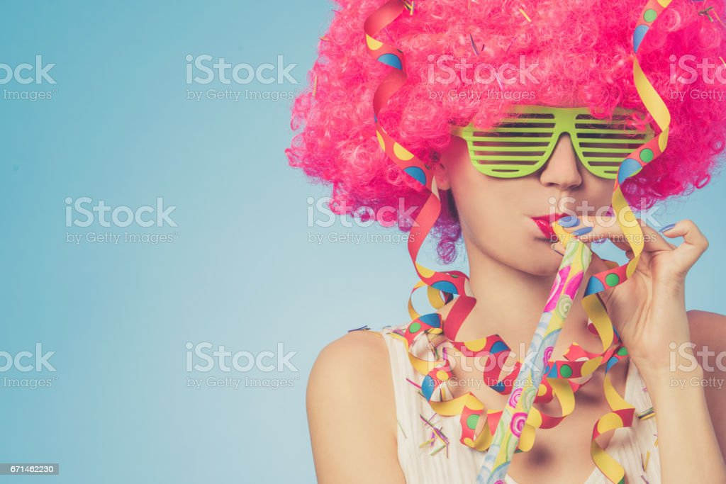 Portrait of beautiful woman in pink wig and green glasses stock photo