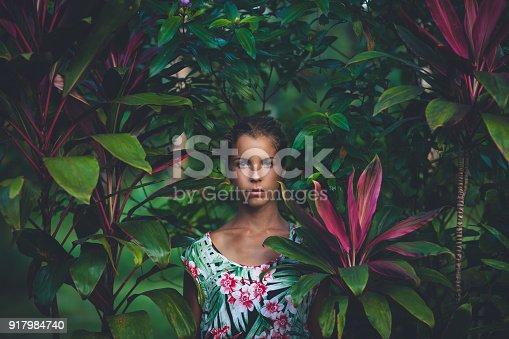Portrait of beautiful woman in rainforest