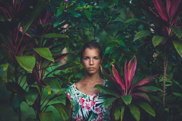 Portrait of beautiful woman in rainforest stock photo