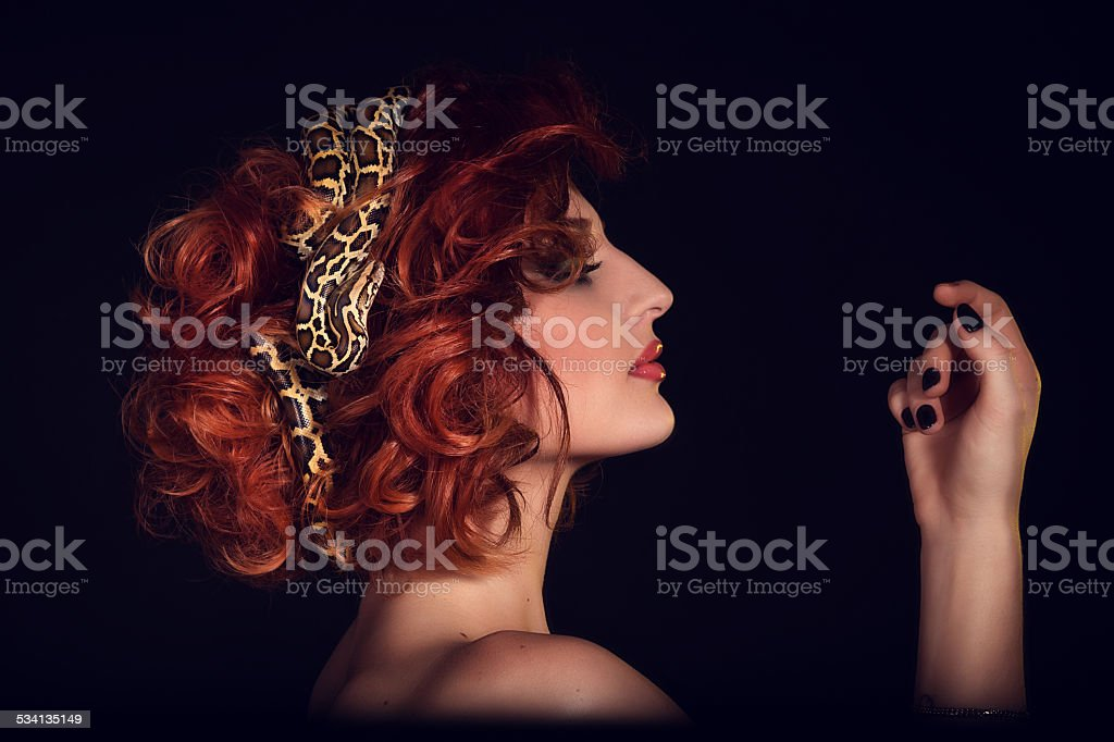 Portrait of Beautiful Woman in studio with dangerous snake stock photo
