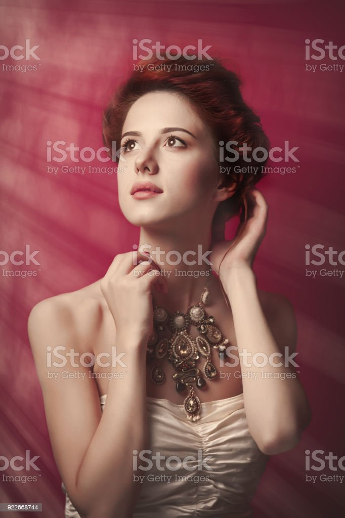 Portrait of beautiful woman in Victorian era clothes stock photo