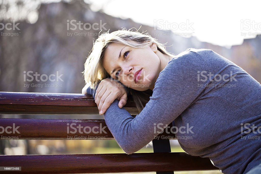 Portrait of beautiful woman leaned on the bench. royalty-free stock photo