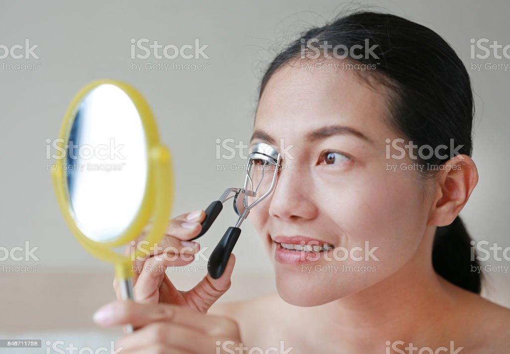 Portrait Of Beautiful Woman Making Curl Eyelashes Beautiful Woman