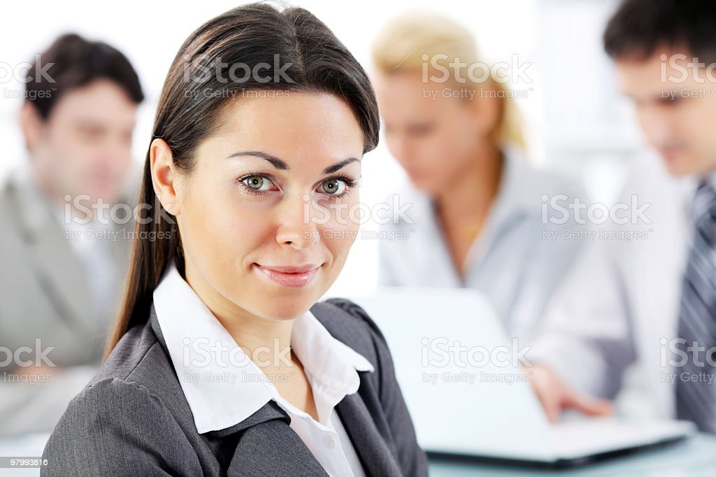 Portrait of beautiful woman on the background a business people royalty free stockfoto