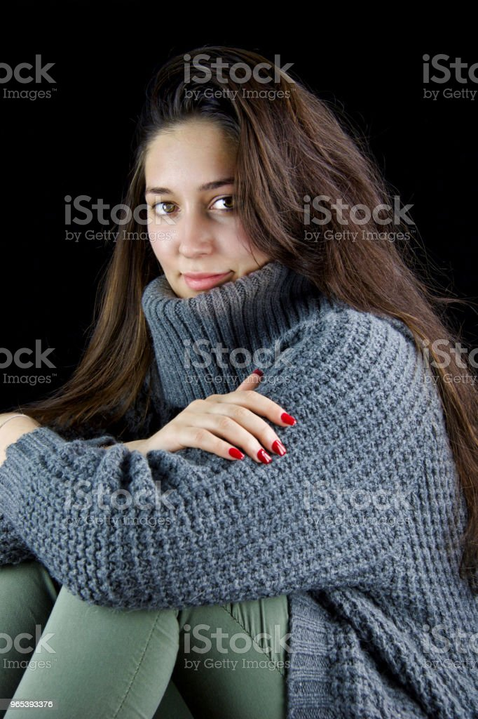 portrait of beautiful woman  sitting with grey wool sweater and red nails royalty-free stock photo