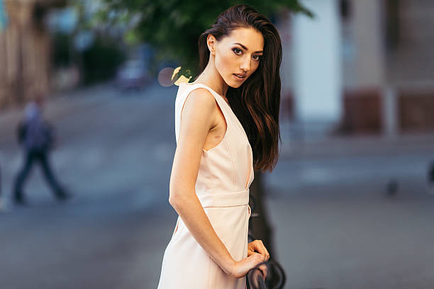 Portrait of beautiful woman standing on the street stock photo