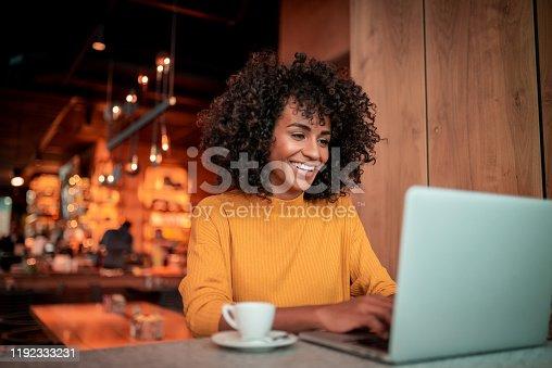Portrait of beautiful woman using a laptop