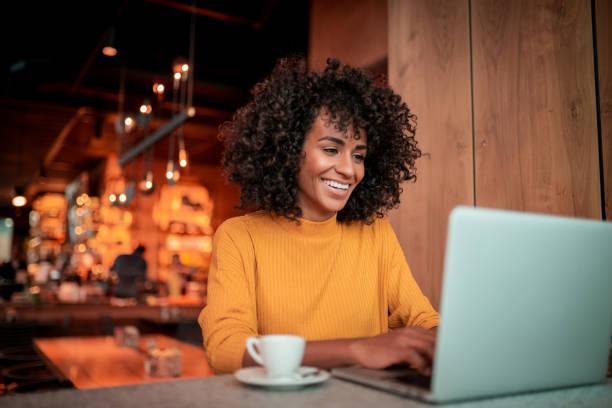 Portrait of beautiful woman using a laptop stock photo