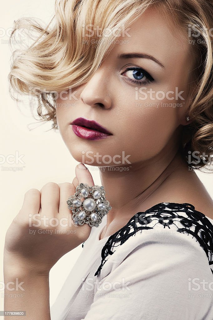 portrait of beautiful woman with a pearl ring. royalty-free stock photo