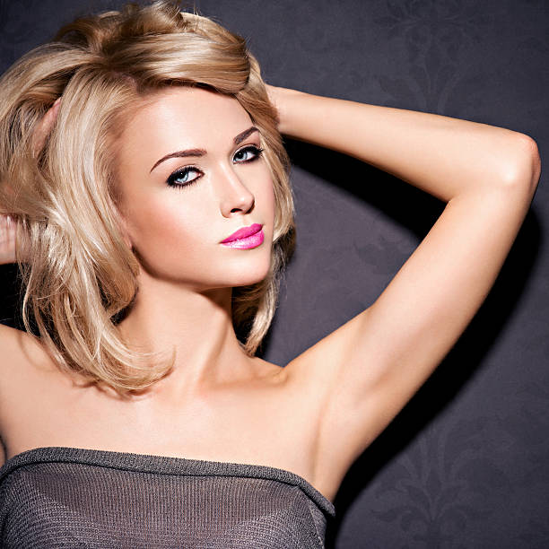 portrait of  beautiful woman with blond hair.  bright fashion ma - medium length hair stock photos and pictures