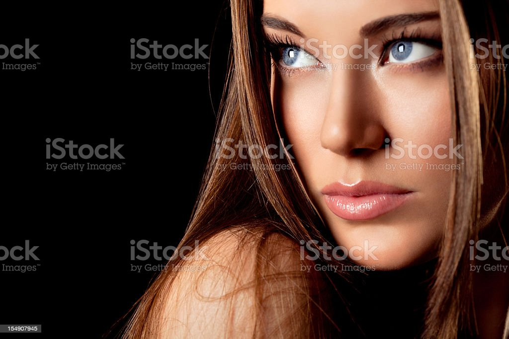 Portrait of beautiful woman with blue eyes stock photo