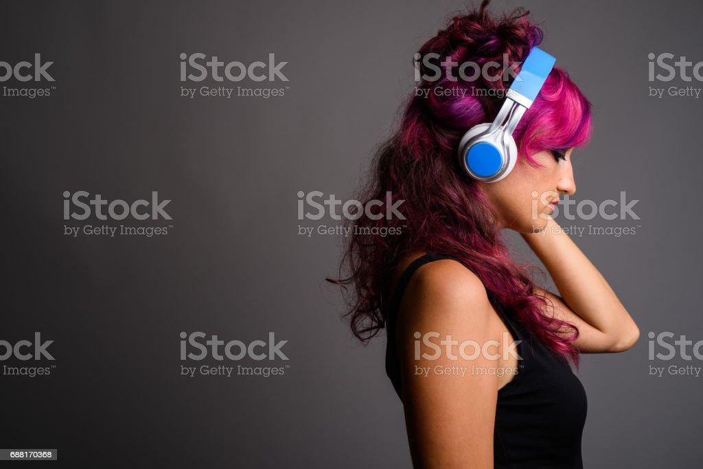 Portrait of beautiful woman with eccentric pink color hairstyle stock photo