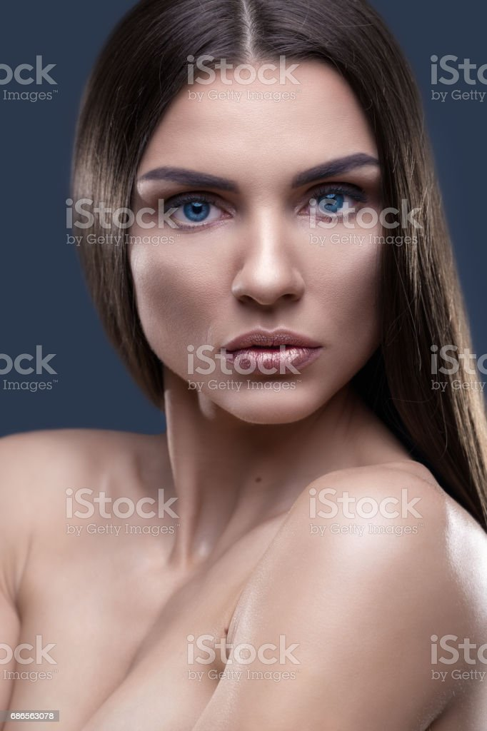 Portrait of beautiful woman with glistening hair in studio royalty-free stock photo