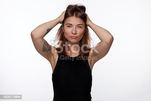 istock Portrait of beautiful woman with short hair winking 1005270894