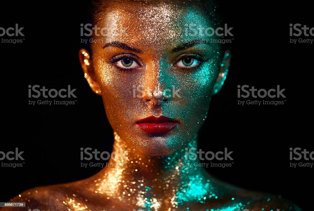 Portrait of beautiful woman with sparkles on her face stock photo