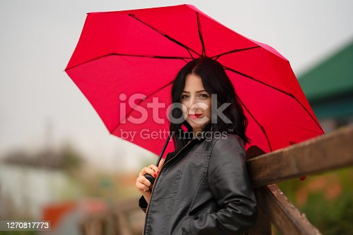 Portrait of beautiful woman with umbrella