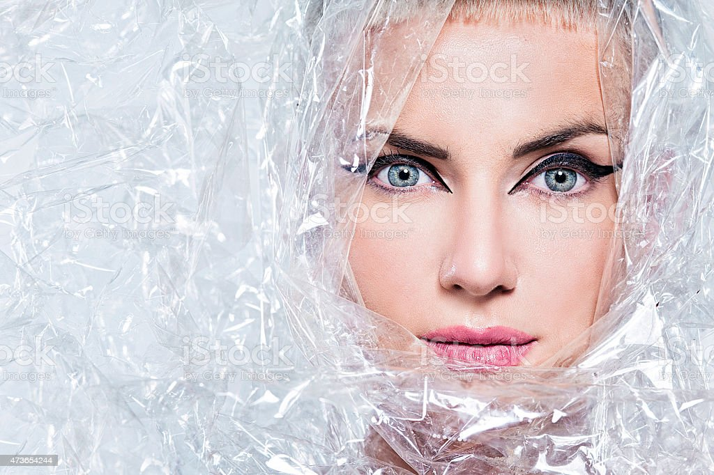 Portrait of beautiful woman, wrapped in cellophane stock photo