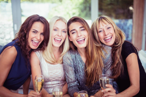 portrait of beautiful women having drink - 30 39 years stock photos and pictures
