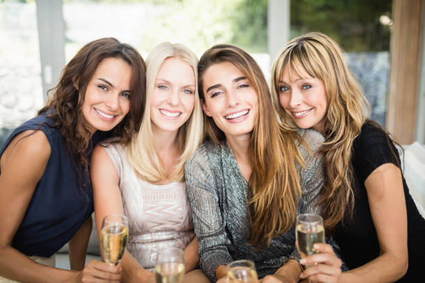 portrait of beautiful women having drinks - 30 39 years stock photos and pictures