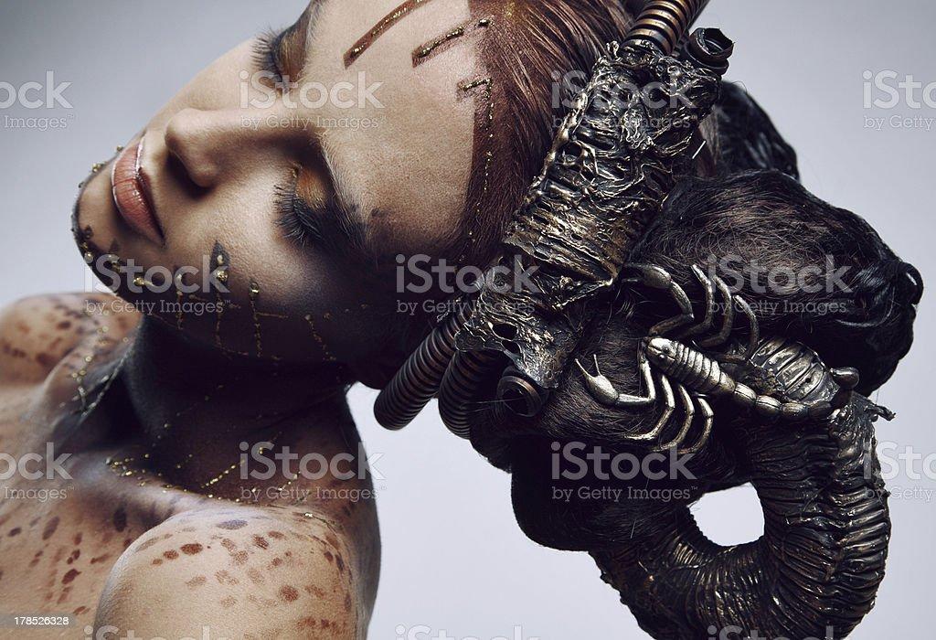 Portrait of beautiful women & scorpion. stock photo