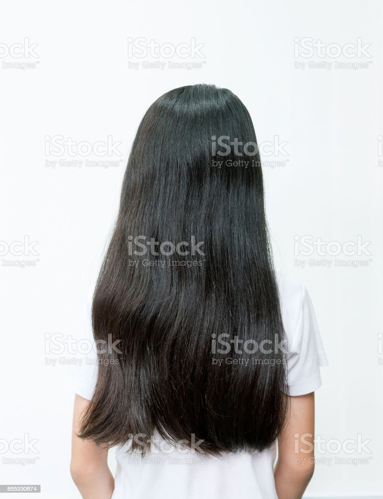 Portrait Of Beautiful Young Asian Teenage Girl With Long Wavy Black