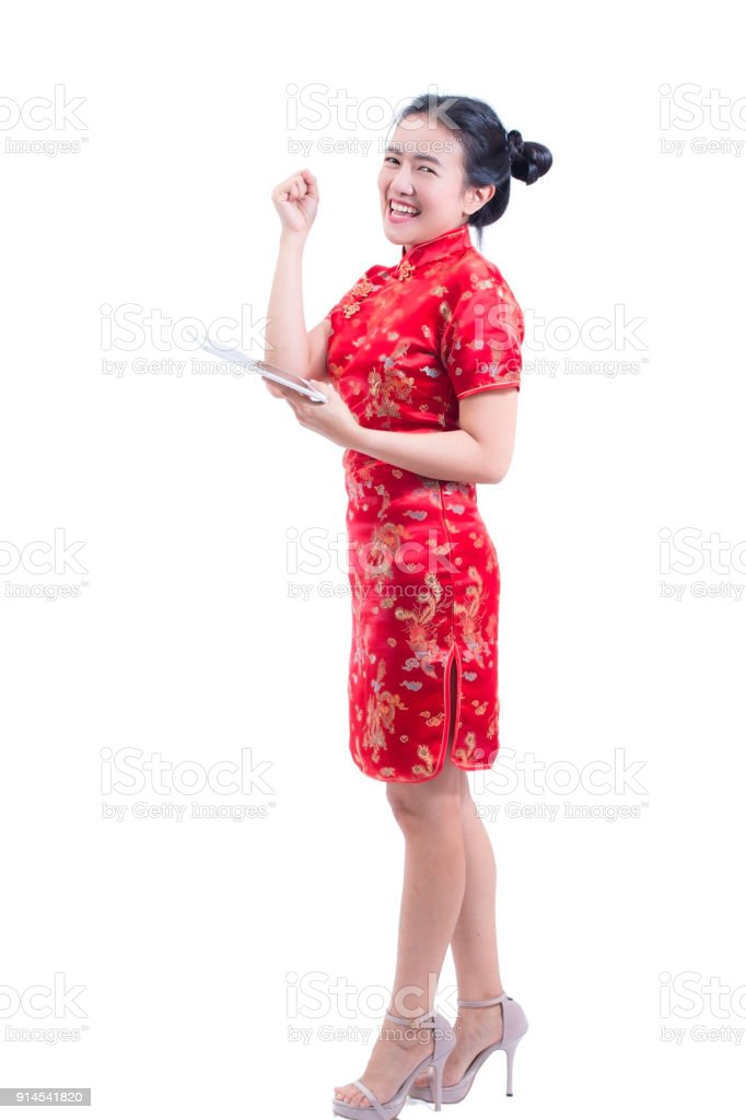 a01c9dbb7 Portrait of Beautiful Young asian woman wear chinese dress traditional  cheongsam or qipao using modern digital tablet and happy smile. shocked  facial ...