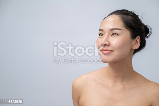 Portrait of Beautiful young asian woman with natural makeup and clean skin