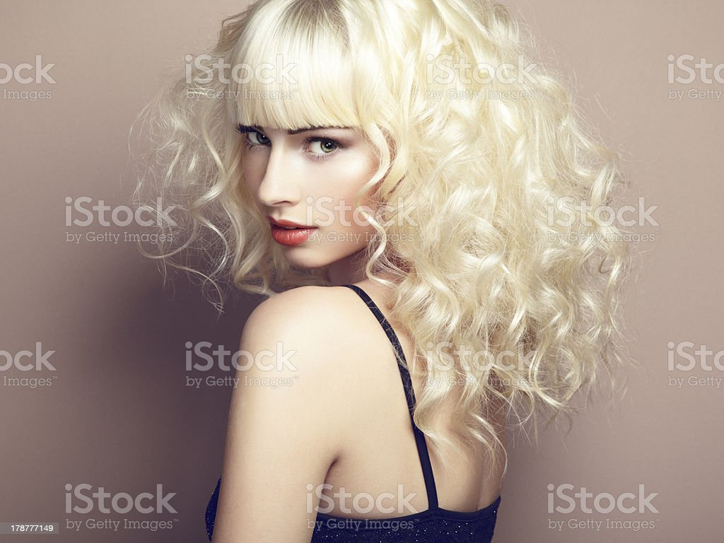 Portrait of beautiful young blonde girl stock photo