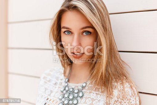 578791454istockphoto Portrait of beautiful young girl in stylish dress with jewels 578791716