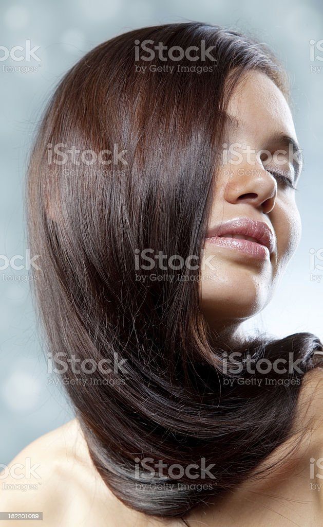portrait of beautiful young girl with long smooth hairs royalty-free stock photo
