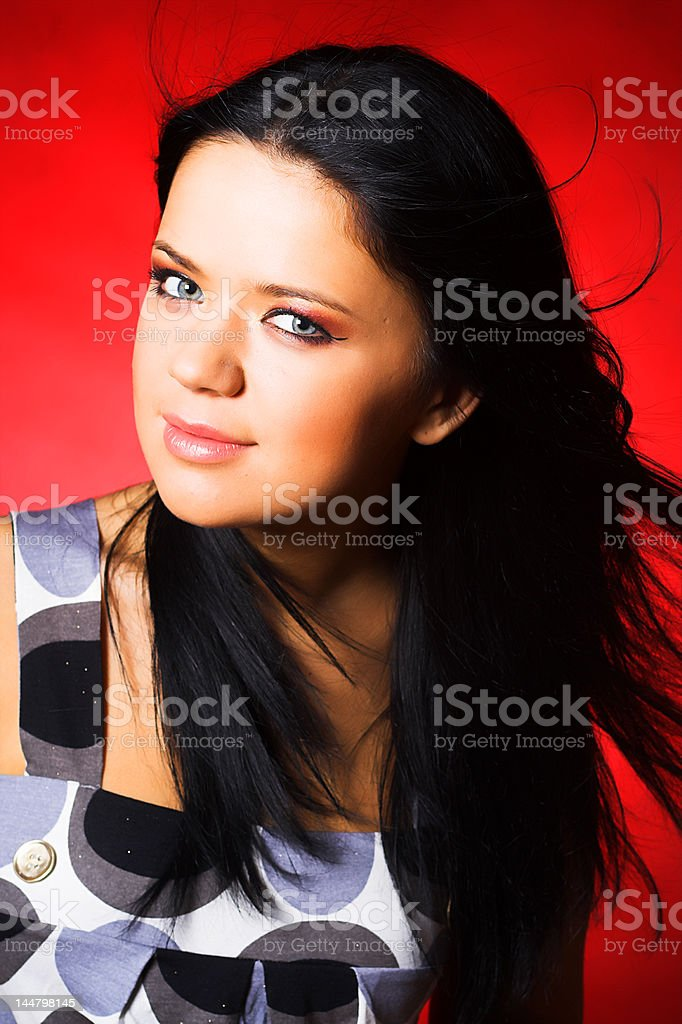 Portrait of beautiful young sexy woman on red background royalty-free stock photo
