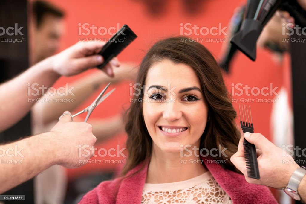 Portrait of beautiful young woman getting haircut at luxury salon royalty-free stock photo