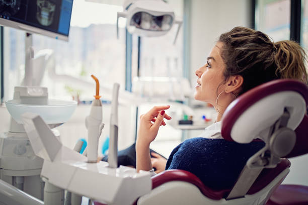 Portrait of beautiful young woman in the dentist office stock photo
